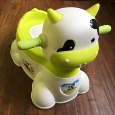 Музыкальный детский горшок-игрушка в виде коровы (зеленый)
